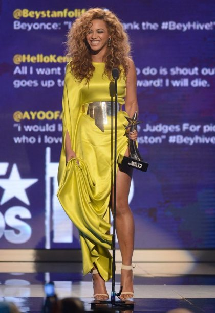 Beyonce receives one of her awards at the 2012 BET Awards