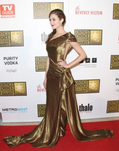 Emmy Rossum's liquid gold Donna Karan gown drew mixed reviews