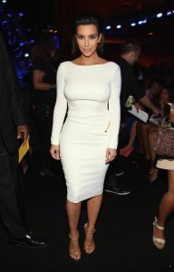 Kim Kardashian in a seemingly demure white Tom Ford frock